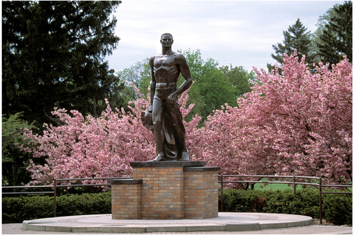 sparty statue with pink flowers