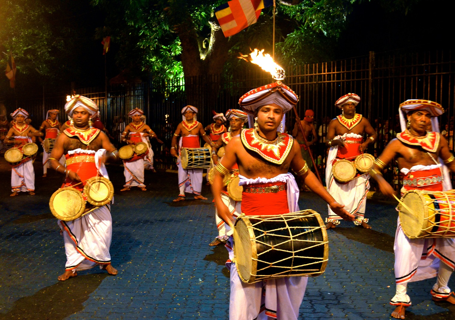 male performers on stage with drums