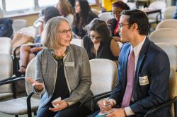 Wenda Bauchspies talks with Community Board member Ethan Schmitt of Planned Parenthood Advocates of Michigan at the 2019 Annual Reception