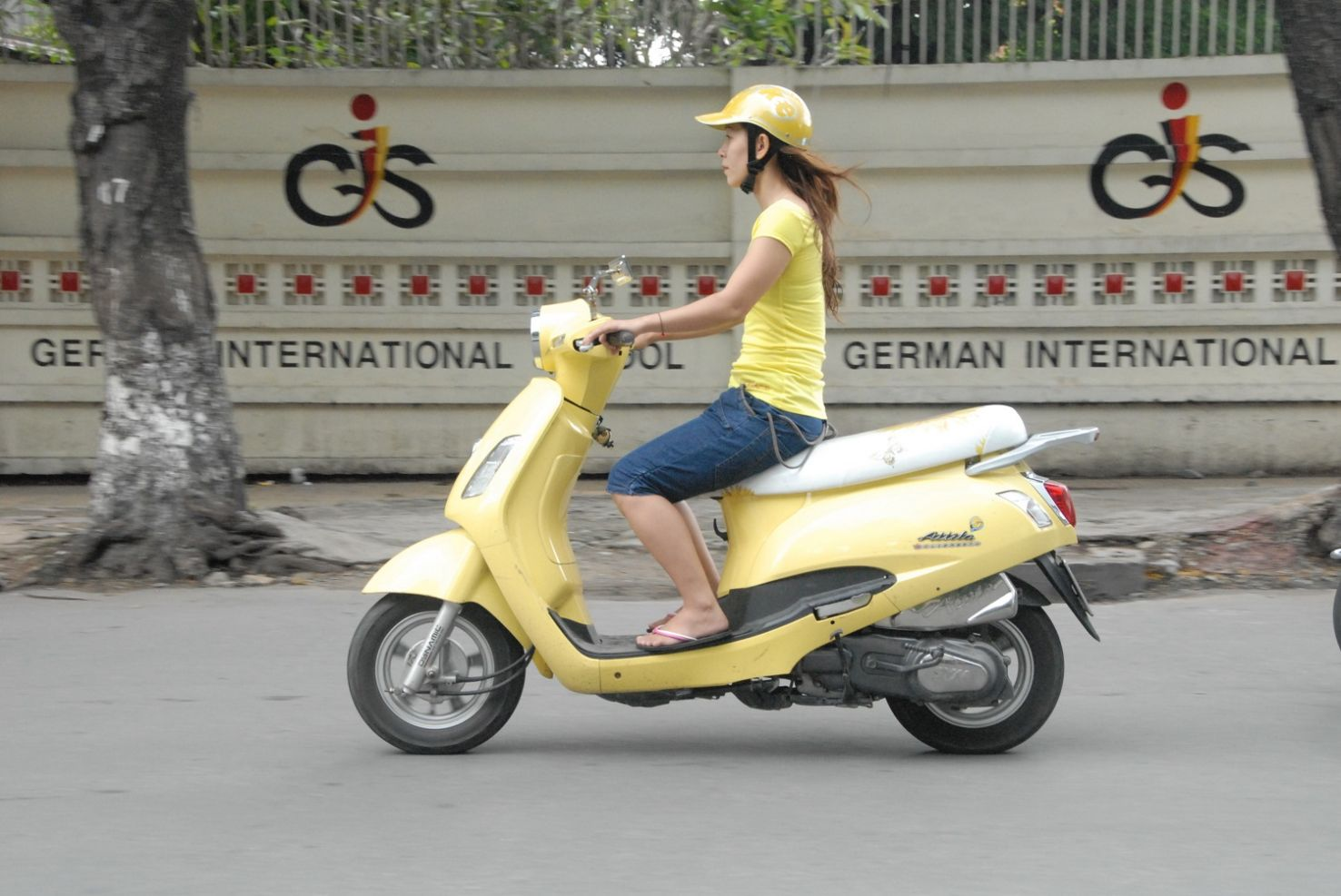 Woman riding scooter